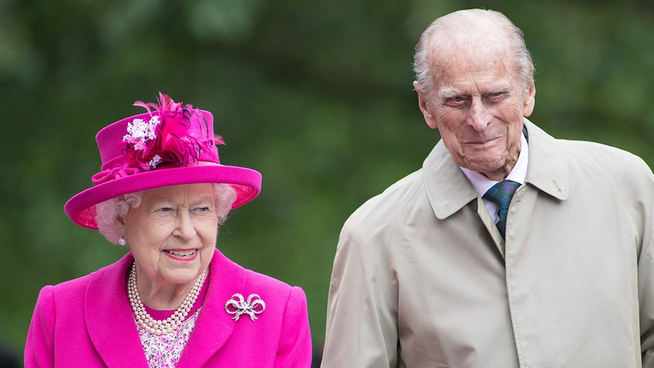 Queen Elizabeth is 'distraught' over Prince Philip's health woes, source claims: 'It's been a rough few weeks'