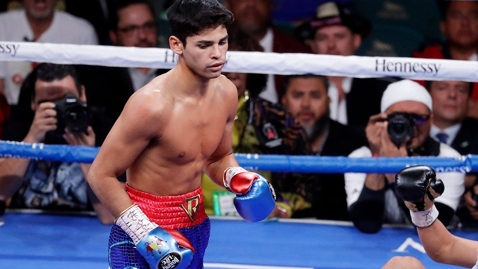 Young rising star Garcia stops Campbell in 7th round