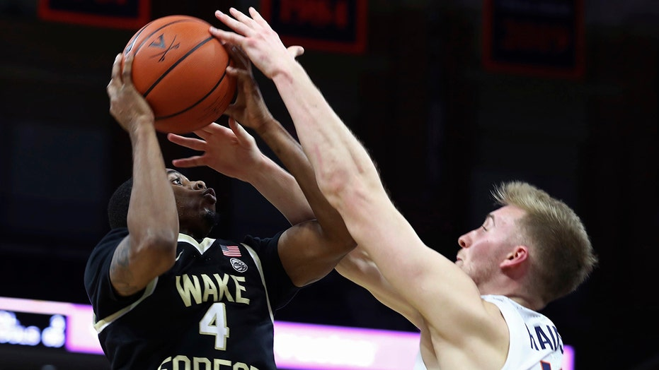 Hauser sparks No. 22 Virginia past Wake Forest, 70-61