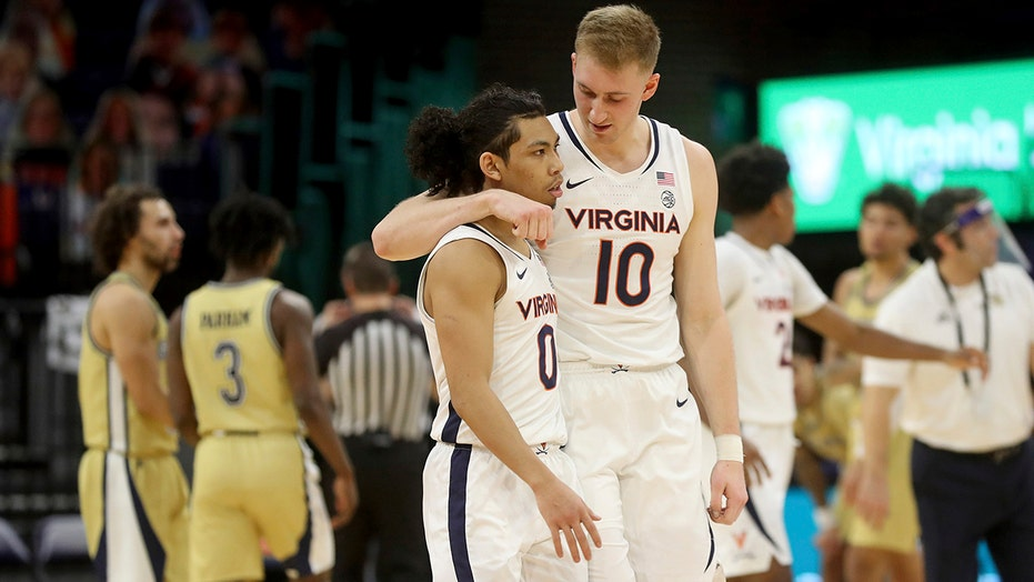 Hauser, Clark lift No. 13 Virginia past Georgia Tech, 64-62