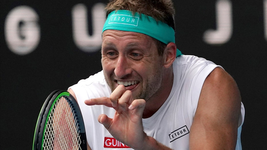 Sandgren gets OK to fly to Australia despite COVID-19 result