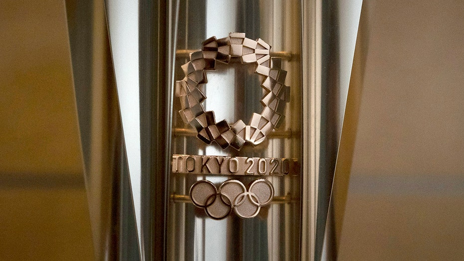 Spreading virus pulls Olympic torches off display in Japan