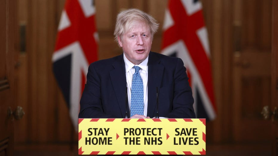 China targets PM Boris Johnson after suggestion coronavirus could have spread from grinding pangolin