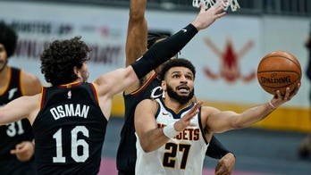 Murray scores historic 50 as Nuggets down crumbling Cavs