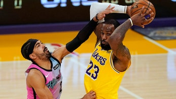 Heat hold off depleted Lakers 96-94 in NBA Finals rematch