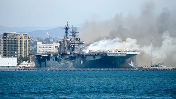 USS Bonhomme Richard, Navy assault ship damaged by fire, should be sunk, lawmakers say