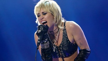 Miley Cyrus gets emotional during Super Bowl 2021 performance of 'Wrecking Ball'