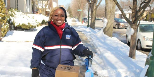Shonda Lemon, 34, working at her job as a USPS mail carrier in Chicago (Photo courtesy of Shonda Lemon/Fox Television Stations)