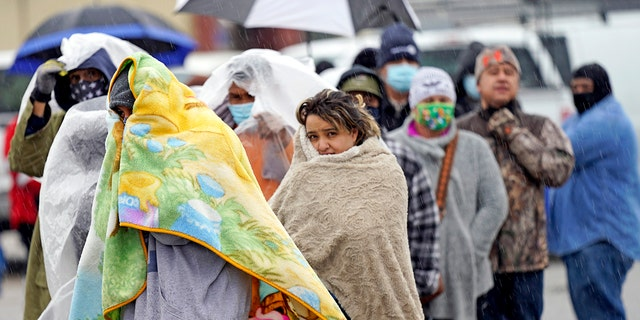People wait in line to fill propane tanks Wednesday, Feb. 17, 2021, in Houston. (Associated Press)