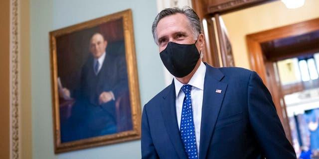 Sen. Mitt Romney, R-Utah, arrives at the Senate for a roll call vote to confirm Antony Blinken, President Joe Biden's nominee to be secretary of state, at the Capitol in Washington, Tuesday, Jan. 26, 2021. (AP Photo/J. Scott Applewhite)