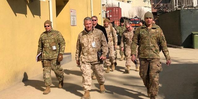 Marine Gen. Frank McKenzie, center, top U.S. commander for the Middle East, makes an unannounced visit in Kabul, Afghanistan. (AP Photos/Lolita Baldor, File)