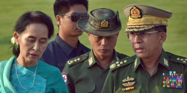 In this May 6, 2016, file photo, Aung San Suu Kyi, left, Burma's foreign minister, walks with senior General Min Aung Hlaing, right, Burma military's commander-in-chief, in Naypyitaw, Burma. (AP Photo/Aung Shine Oo, File)