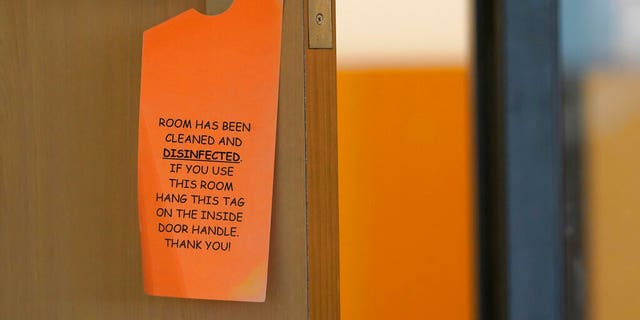 A sign that indicates a room has been disinfected hangs in a fourth-grade classroom, Tuesday, Feb. 2, 2021, at Elk Ridge Elementary School in Buckley, Wash.?