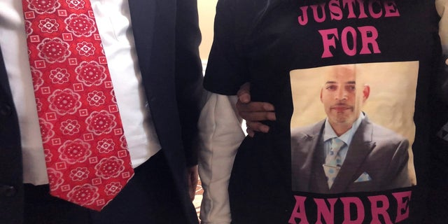 Andre Hill, fatally shot by Columbus police on Dec. 22, is memorialized on a shirt worn by his daughter, Karissa Hill, on Thursday, Dec. 31, 2020, in Columbus, Ohio. (AP Photo/Andrew Welsh-Huggins)