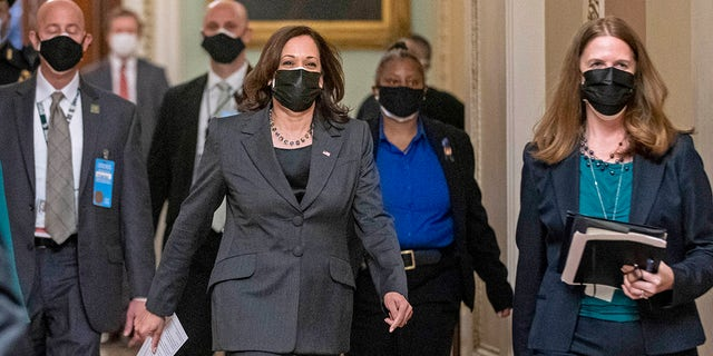 FILE: Vice President Kamala Harris arrives to hold mock swearing-in ceremonies for Senators in the Old Senate Chamber at the U.S. Capitol in Washington, Thursday, Feb. 4, 2021. (AP Photo/Andrew Harnik)