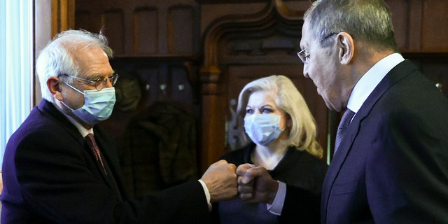 In this photo released by the Russian Foreign Ministry Press Service, Russian Foreign Minister Sergey Lavrov, right, and High Representative of the EU for Foreign Affairs and Security Policy Josep Borrell wearing a face mask to protect against coronavirus, greet each other prior to their talks in Moscow, Russia, Friday, Feb. 5, 2021. (Russian Foreign Ministry Press Service via AP)