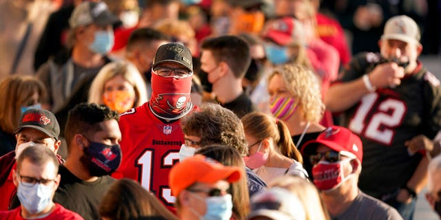 In this Feb. 4, 2021, file photo, people wait in line for an exhibit at the NFL Experience in Tampa, Fla. The city is hosting Sunday's Super Bowl football game between the Tampa Bay Buccaneers and the Kansas City Chiefs. (AP Photo/Charlie Riedel, File)