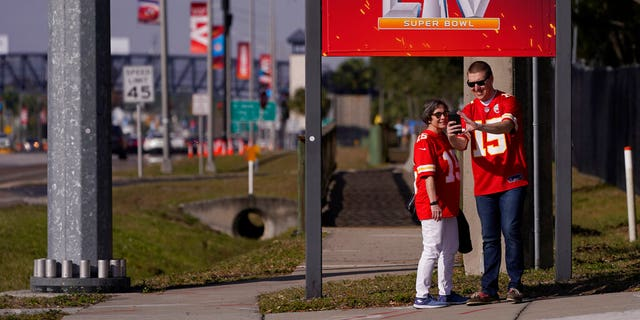 In this Feb. 4, 2021, file photo, Kansas City Chiefs fans take a selfie outside of Raymond James Stadium ahead of Super Bowl 55 in Tampa, Fla. (AP Photo/Charlie Riedel, File)