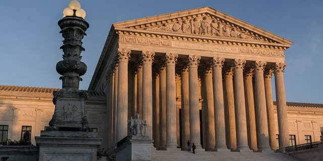 FILE - In this Friday, Nov. 6, 2020 file photo, The Supreme Court is seen at sundown in Washington. (AP Photo/J. Scott Applewhite, File)