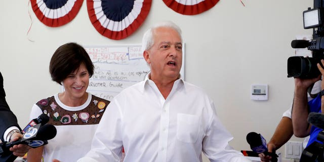 California Republican gubernatorial candidate John Cox speaks during campaign stop as Rep. Mimi Walters, R-Calif., looks on in Irvine, Calif. (AP Photo/Chris Carlson, File)