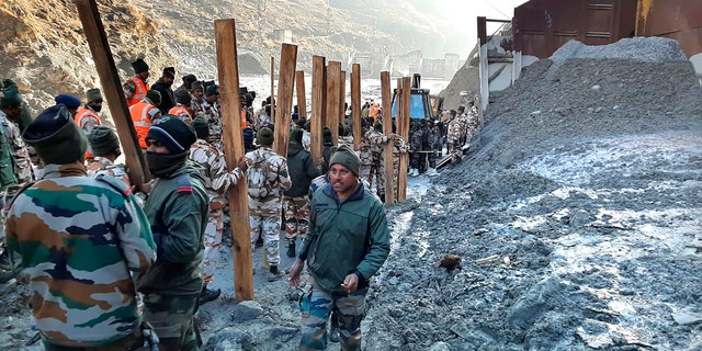 Indo Tibetan Border Police (ITBP) personnel undertake rescue work at one of the hydro power project at Reni village in ??Chamoli district, in Indian state of Uttrakhund, Monday, Feb.8, 2021. Rescue efforts continued on Monday to save 37 people after part of a glacier broke off, releasing a torrent of water and debris that slammed into two hydroelectric plants on Sunday. (AP Photo)