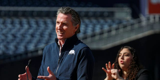 California Governor Gavin Newsom speaks at a news conference at Petco Park, which will host a vaccination site in a parking lot next to the ballpark in a partnership between San Diego County, the San Diego Padres baseball team, and UC San Diego Health, Monday, Feb. 8, 2021, in San Diego.