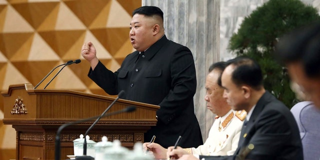In this photo provided by the North Korean government, North Korean leader Kim Jong Un, left, attends at a meeting of Central Committee of Worker's Party of Korea in Pyongyang, North Korea, Monday, Feb. 8, 2021. (Korean Central News Agency/Korea News Service via AP)