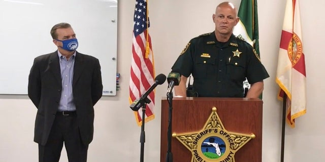 In this screenshot from a YouTube video posted by the Pinellas County Sheriff's Office, Pinellas County Sheriff Bob Gualtieri speaks during a news conference as Oldsmar, Fla., Mayor Eric Seidel, left, listens, Monday, Feb. 8, 2021, in Oldsmar, Fla. (Pinellas County Sheriff's Office via AP)