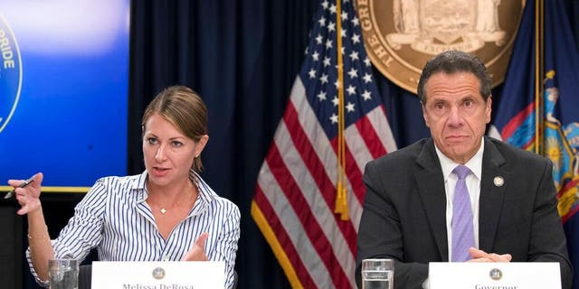 Secretary to the Governor Melissa DeRosa is joined by New York Gov. Andrew Cuomo as she speaks to reporters during a news conference, in New York City, Sept. 14, 2018. (Associated Press)