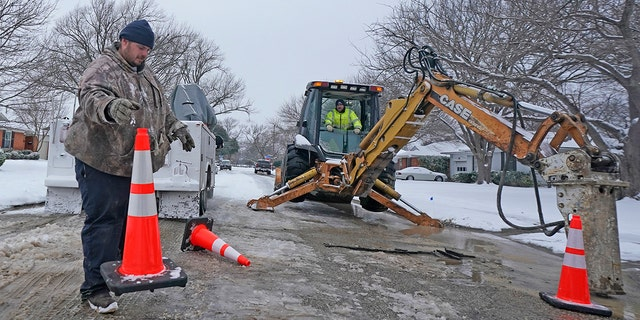 Workers in Richardson, Texas, prepare to work on a water main pipe that burst due to extreme cold in a neighborhood Wednesday, Feb. 17, 2021. (Associated Press)