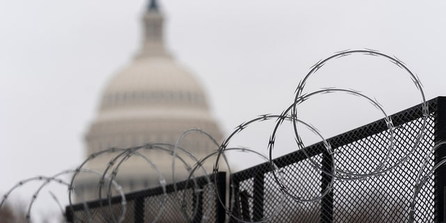 The U.S. Capitol is seen behind the razor fence around the U.S. Capitol, Thursday, Feb. 18, 2021. (Associated Press)