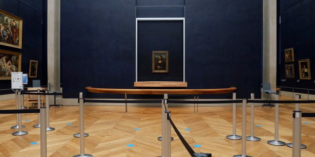 Leonardo da Vinci's Mona Lisa hangs on the wall in a deserted Louvre museum. (AP Photo/Thibault Camus)