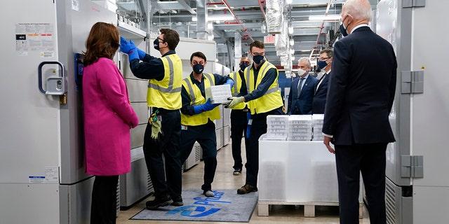 President Joe Biden, right, and Michigan Gov. Gretchen Whitmer, left, tour a Pfizer manufacturing site in Portage, Mich on Feb. 19, 2021. (AP Photo/Evan Vucci, File)