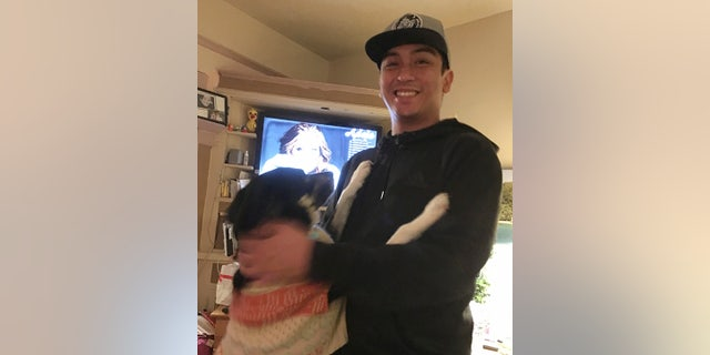 This Jan. 4, 2018 photo provided by Isabella Collins, Navy veteran Angelo Quinto smiles at his home in Berkeley, Calif. (Isabella Collins via AP)