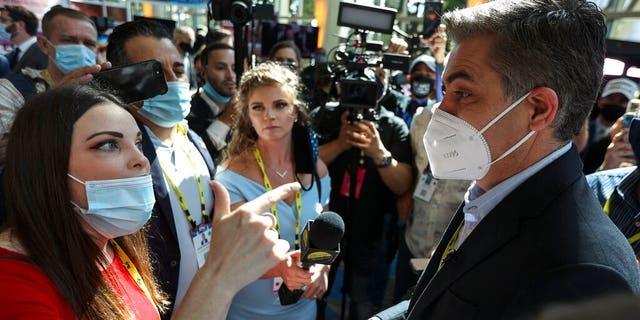 A woman argues with CNN reporter Jim Acosta outside the Conservative Political Action Conference (CPAC) on Friday, Feb. 26, 2021, in Orlando, Fla.