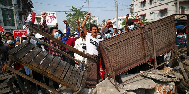 Protesters shout slogans as police arrive during a protest against the military coup in Mandalay, Myanmar, Sunday, Feb. 28, 2021. (Associated Press)