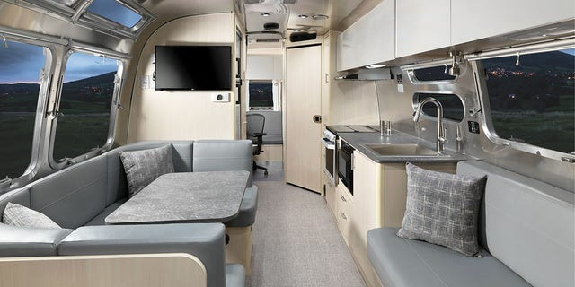 In addition to a sound proof office space, the Flying Cloud 30FB, has lifestyle amenities like a TV and kitchen. (Airstream)