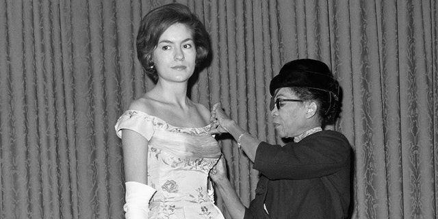 Ann Lowe adjusts the the bodice of a gown she designed in this 1962 photo.