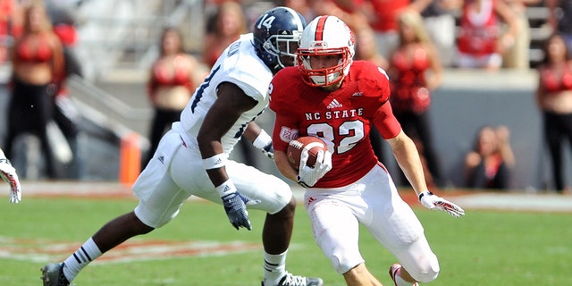 Bo Hines #82 of the North Carolina State Wolfpack runs with the ball against Tay Hicklin #14 of the Georgia Southern Eagles at Carter-Finley Stadium on Aug. 30, 2014 in Raleigh, N.C. (Lance King/Getty Images)