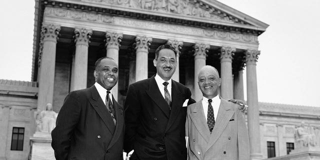 Attorneys who argued the case against segregation stand together smiling in front of the U.S. Supreme Court Building after the High Tribunal ruled that segregtion in public schoolsis unconstitutional. Left to right are: George E.C. Hayes, Washington, DC; Thurgood Marshall, special counsel for the NAACP; and James Nabrit, Jr., Progessor and Attorney at law at Howard University in Washington.