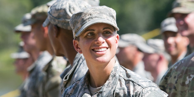 Capt. Kristen Griest smiles at the audience gathered during the graduation ceremony of the United States Army's Ranger School on August 21, 2015 at Fort Benning, Ga. (Getty Images)
