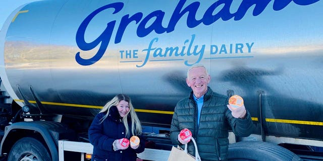 Charlene Leslie has since been awarded a year's supply of free milk after lending a helping hand.