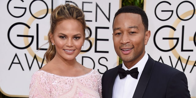 Chrissy Teigen and John Legend attended the Golden Globes together in 2015. (Photo by Frazer Harrison/Getty Images)