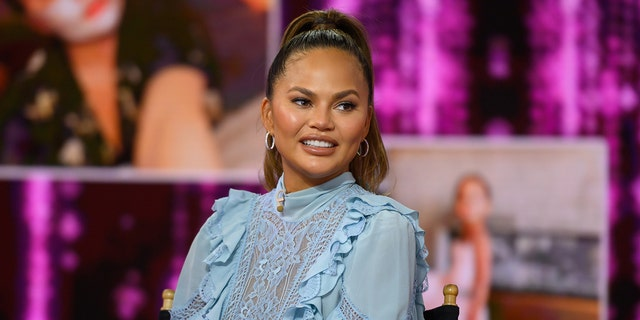 Chrissy Teigen joked about her 2015 viral moment from the Golden Globes, calling herself a 'dumba--.'