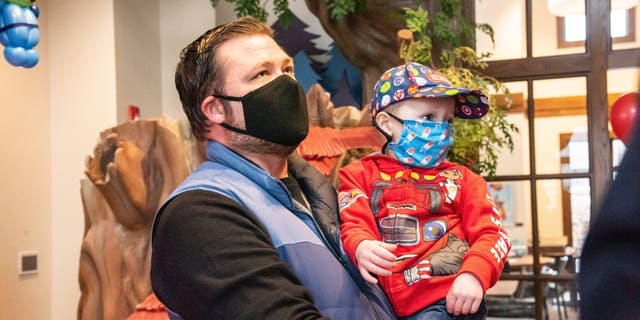 Christopher Milecki, 3, is carried into the Ronald McDonald House Charities Maryland headquarters by his father, Mark. (Olivia Bush Photography)
