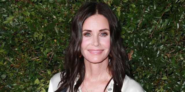 Courteney Cox showed off her piano skills by playing the iconic 'Friends' theme song, 'I'll Be There for You,' by The Rembrandts. (Photo by Rich Fury/Getty Images)