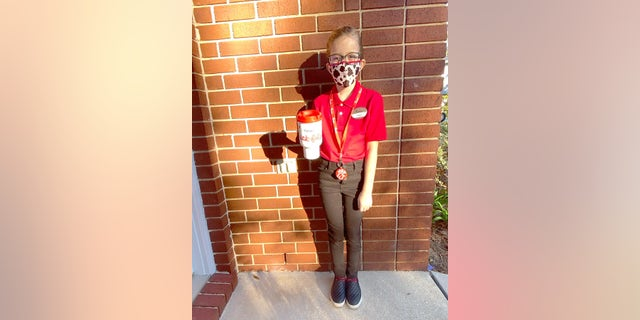 """Harper Mahaney recently went all-out for """"Dress Up LikeEveryday Heroes"""" day at Gulf Breeze Elementary School, paying tribute to Chick-fil-A."""