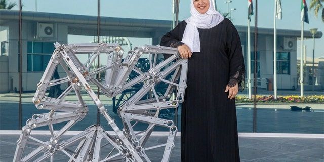 Etihad Airways has partnered with two artists to upcycle old plane parts into art installations at the airline's Abu Dhabi headquarters. Azza Al Qubaisi is pictured with her sculpture.