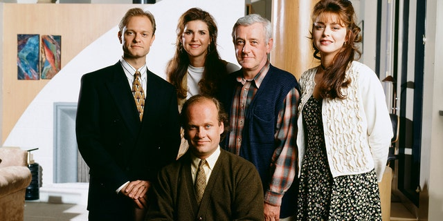'Frasier' -- Pictured: (Back, l-r) David Hyde Pierce as Doctor Niles Crane, Peri Gilpin as Roz Doyle, John Mahoney as Martin Crane, Jane Leeves as Daphne Moon, (Front, seated) Kelsey Grammer as Doctor Frasier Crane