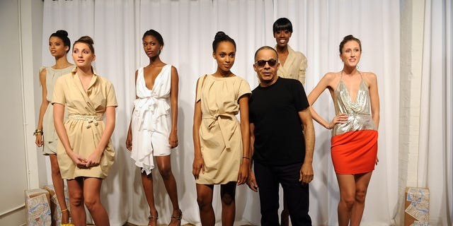 Designer Stephen Burrows poses with models at the Stephen Burrows Spring 2011 presentation during Mercedes-Benz Fashion Week in 2010.